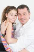 A nice young girl with her father — Stockfoto
