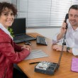 At work a manager and woman — Stock Photo #65820305