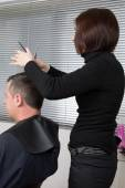 Nice man at hairdresser — Stock Photo