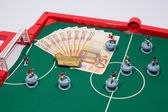 Figures of football player on euro banknotes — Stock Photo