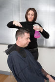 Man at hairdresser — Stock Photo