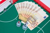 Figures of football players on euro — Stock Photo