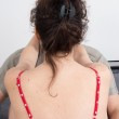 Back view of a nice red dress in a  woman — Zdjęcie stockowe #68490283