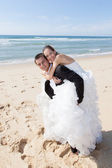 Wedding couple at the beach — Stock Photo