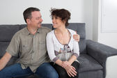 Love and complicity on sofa — Stock Photo
