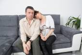 Relaxing couple on the sofa — Stock Photo