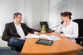 At work, man and woman — Stock Photo