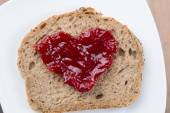 Love concept with bread and marmelade — Stock Photo