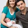 Proud Parents With their Baby at Home — Stock Photo #73661905