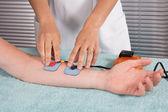 Man is doing massage of electrostimulator Medical procedure. — Stock Photo