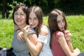 Mother with her daughters — Stock Photo