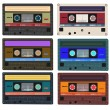 Collection of vector retro audio cassettes. Set of different colorful music tapes. Isolated on white background. Vector art eps10 — Stock Vector #80198058