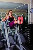 Her core workout includes leg lifts on the Roman Chair — Stock Photo
