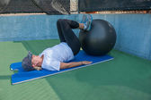 Supine leg curls on stability ball — Stock Photo