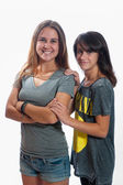 Younger sister catching up in height — Stock Photo