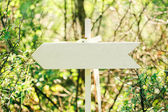 Wooden arrow sign — Stock Photo