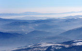 A view of blue mountain hills with snow — Stock Photo