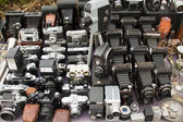 Lots of vintage cameras and lenses — Stockfoto