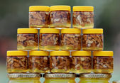 Honey with nuts — Stock Photo