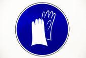 знак спецодежды защиты перчаток — Стоковое фото