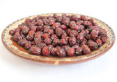 Dried rose hips plate — Stock Photo