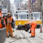 Постер, плакат: Tram road workers repair repairing hummer