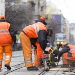 Постер, плакат: Tram road workers repair repairing