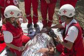 Volunteers Red Cross voluntery organization — Stock Photo