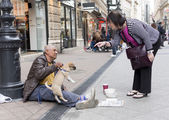 Beggar with dog — Stock Photo