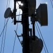 Silhouette of a communication tower in the mountain — Stock Photo #78910720