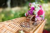 Bridal bouquet on a suitcase — Stock Photo