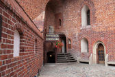 In yard of Teutonic castle in Malbork — Stock Photo