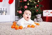 Portrait of baby with tangerine — Stock Photo