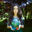 Young beautiful girl with gold fish — Stock Photo #65298725