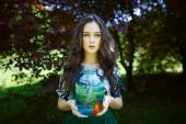 Young beautiful girl with gold fish — Stok fotoğraf