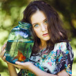 Young beautiful girl with gold fish — Stock Photo #65369021