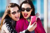 Two happy women making selfie photo — Stock Photo