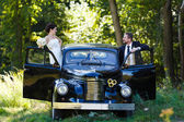 A wedding couple with old car — Stock Photo
