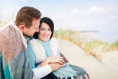 Happy couple in a dune — Stock Photo