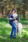 Happy girl with husky dog — Stock Photo