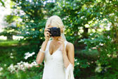 Bride with camera — Stock Photo