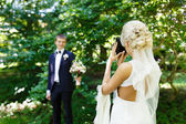 Bride shooting of her fiance — Stock Photo