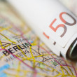 Euro banknotes on a geographical map of Berlin — Stock Photo #76764529