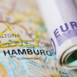 Euro banknotes on a geographical map of Hamburg — Stock Photo #76764629