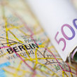 Euro banknotes on a geographical map of Berlin — Stock Photo #76764639