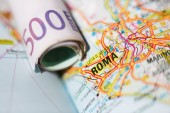 Euro banknotes on a geographical map of Roma — Stock Photo