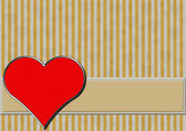 Red chrome heart on silver and gold stripes — Stock Photo