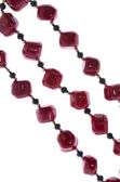 Fragment of red beads on a white background — Stock Photo