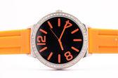 Relógio laranja em fundo branco — Fotografia Stock