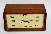 Wooden table clock on white background — Stock Photo